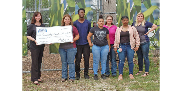In its inaugural year, the Sav-A Caf® Youth Impact Award was presented by Milk Products, maker of Sav-A-Caf®, to the Vincent High School FFA. Pictured are, left to right: Tanya Gilbertson, Milk Products; Monica Gahan, award winner; Monteel Powell, student; Divine Reynolds, student; Stefanie Fieck, Milk Products; Kiara Little, student; and Meghan Sawdy, award nominator. (Courtesy of Sav-A-Caf®)