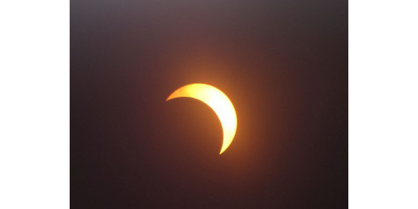 Photo 1. Partial solar eclipse Aug. 21, 2017, at Southfield, Michigan. (Photo courtesy of R.J. Jones, Victoria Kwao, and Cheryl Carvery-Jones)