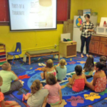 Whitney Jorgensen teaches the parachute lesson at the Sibley Public Library. (Courtesy of Iowa State University Extension and Outreach)