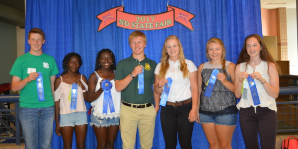 The Walsh County team of (from left) Noah Zikmund, Sandra Kjelland, Beatrice Kjelland, Toby Zikmund, Kristen Larson, Sydney Beneda and Annah Zikmund took first place in the senior division of the consumer choices contest held during the North Dakota State Fair. (NDSU photo)