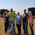 Cassidy Kreigh (right) poses with the Schemm family during the 2017 wheat harvest. (Courtesy of Kansas Wheat)