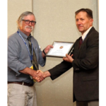 Jeff Suttle (left) receives his Honorary Life Membership Award from longtime friend and co-worker Ed Lulai, chemist at USDA-ARS. (Courtesy of Northern Plains Potato Growers Association)