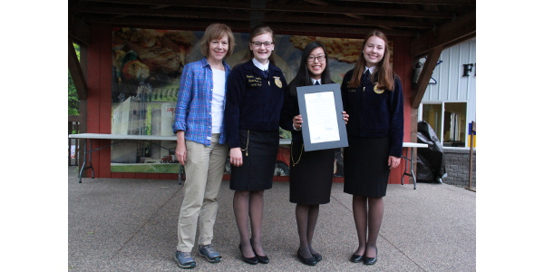 "Lt. Governor Tina Smith presents the proclamation for ""FFA Day at the Fair"" at the Minnesota State Fair. (Courtesy of Office of Governor Mark Dayton & Lt. Governor Tina Smith)"