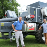 Aaron Hager and Adam Davis with Harrington Seed Destructor, U of I South Farms, Aug. 2015. Photo By Stephanie Henry.