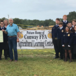FCS Financial Rural Community and Agriculture Foundation presents $10,000 to the Laclede County R-I School district and Conway FFA for the construction of the Conway Ag Learning Center. Left side front row (l-r): Roger Ash (FCS Financial), Lauren Whitehead, Shea Walker, Megan Manley, Wayne Whitehead. Back row (l-r): Mandy Peters (FCS Financial), Blair Wilkerson (FCS Financial), MaKayla Caselman, Mary Ann Keck. Right side front row (l-r): Jada Webster, Emily Livingston, Greg Brown (FCS Financial). Middle row (l-r): Jared Spradling, Simon Livingston, Rick Lowrance, Kenny Bergmann (FCS Financial Board Member). Back row: Dakota Cushing, James Shockley, Bud Triplett, Hayden Graves, David Janish (FCS Financial), Mark Hedger. (Courtesy of FCS Financial)