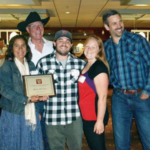 John & Janine Putnam of Thistle Hill Farm in North Pomfret, VT were awarded the National Quality Award, which recognizes the Horizon farmer partner who produces the highest-quality organic milk in Horizon's milk supply. Pictured from left to right are Janine Putnam, Tom Spohn, Ian Putnam, Billie Jo Kiel, and Matt Kuusinen. (Courtesy of Horizon Organic)
