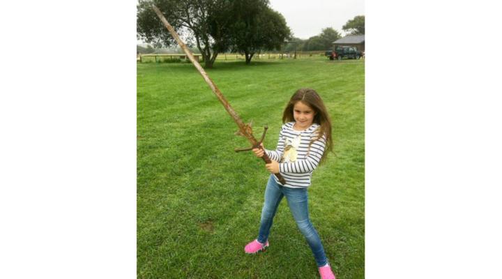 Girl pulls sword out of King Arthur's lake