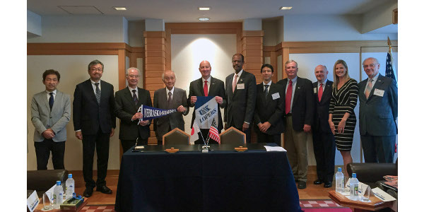 Nebraska Gov. Pete Ricketts, middle, and UNK's Gilbert Hinga, sixth from left, and Satoshi Machida, seventh from left, meet with Nebraska, U.S. and Japanese dignitaries Monday at the Midwest-U.S. Japan Association conference in Japan. UNK signed a student and faculty exchange agreement at the conference with Toyo University. (Courtesy of UNK)