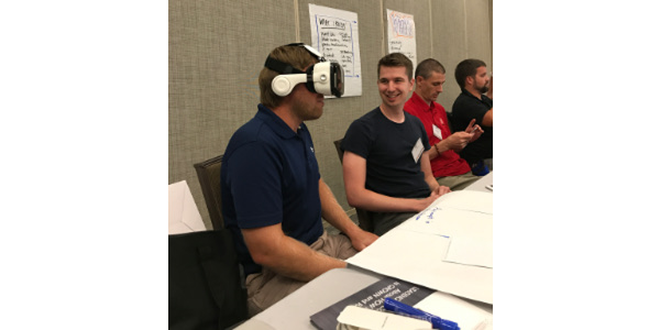 High school educators had the opportunity to learn about modern agriculture using a virtual reality headset. (Courtesy of Minnesota Soybean)