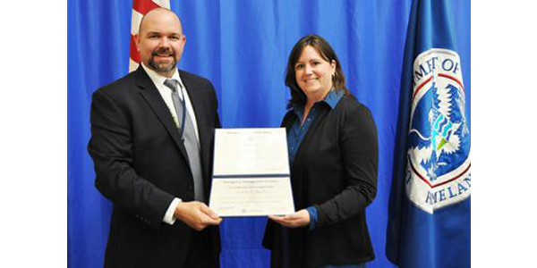 Paul Butki, acting superintendent of EMI, congratulates UK's Andrea Higdon on her graduation. (PHOTO: Shane Gibbon/FEMA)