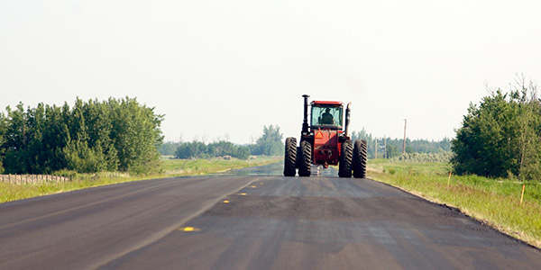 Farm equipment is large and heavy, making it hard for operators to accelerate, slow down and stop. The equipment also makes wide turns and sometimes crosses over the center line. In addition, farm vehicles can create large blind spots, making it difficult for operators to see approaching vehicles.(Courtesy of Minnesota Dept. of Transportation)