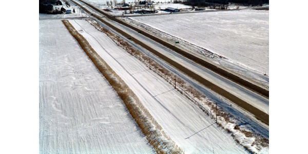 """""""The Living Snow Fence program is a great way for us to give back to our community and be an advocate for safer driving conditions in the winter,"""" said Louise Kiecker, a farmer in Fairfax, Minn. """"Our family and friends travel that road daily and they know that this stretch of the highway will be clear. I really see our participation in the program as a public service."""" (Courtesy of Minnesota Department of Transportation)"""