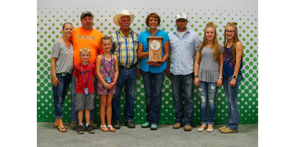 Dale Curtis, Edmunds County was one of six South Dakotans inducted into the South Dakota 4-H Volunteer Hall of Fame during the South Dakota State Fair (posthumously.) His family, pictured here, accepted the honor. (Courtesy of iGrow.org)