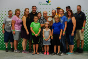 Elaine Kanable, Campbell County, was one of six South Dakotans inducted into the South Dakota 4-H Volunteer Hall of Fame during the South Dakota State Fair. She is pictured with her family. (Courtesy of iGrow.org)