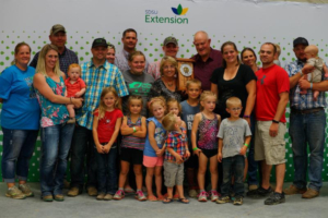 Gerald (Jerry) and Carmen Grace, Minnehaha County, were two of six South Dakotans inducted into the South Dakota 4-H Volunteer Hall of Fame during the South Dakota State Fair. They are pictured with their family. (Courtesy of iGrow.org)