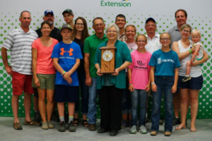 Marsha Howard, Hand County, was one of six South Dakotans inducted into the South Dakota 4-H Volunteer Hall of Fame during the South Dakota State Fair. She is pictured with her family. (Courtesy of iGrow.org)