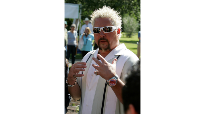 Celebrity Chef Guy Fieri cooks up feast for fire victims