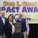 Sharon Schwartz was presented the 2017 Don L. Good Impact Award Oct. 13 during the Kansas State University Animal Sciences and Industry Family & Friends Reunion in Manhattan. Also pictured are: Dr. Ken Odde, left, K-State ASI Department head; and Craig Good, LMIC president. (Courtesy of K-State Research and Extension)