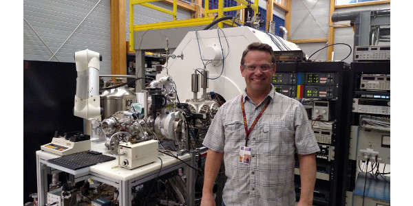 Research scientist Robert Young with the mass spectrometer at Florida State University's MagLab. This instrument helped the CSU scientists identify elemental signatures in a biochar carbon coating. (Courtesy of CSU)