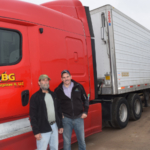 Wisconsin farmers, such as Bill Wysocki of RPE, Inc., shown standing at right with truck driver Kenny Baldwin (left), have a history of being generous, especially to those in need or suffering through a hardship. (Courtesy of Wisconsin Potato & Vegetable Growers Association)