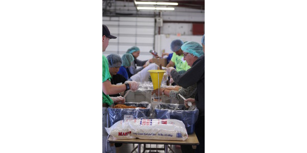 A view from the action on the packing lines at the Meal Packaging Event at the Interstate Center done by Livingston, McLean & Woodford County 4-H & community volunteers. (Courtesy of University of Illinois Extension)