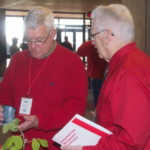 Elywnn Taylor, ISU Extension and Outreach climatologist (right) visits with John Holmes of Clarion, Iowa. (Photo by Brandon Kleinke)