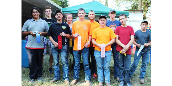 The top winners from the 2017 Illinois 4-H State Archery Shoot in the compound bow divisions included (front, left to right) Dominick Trujillo of Macon County, first; Steve Hilgers of Mason County, second; Jacob Maschino of Edgar County, third; Gavin Coombe of Edgar County, fourth; and John Reutter of McLean County, fifth; (back) Carson McGill of Iroquois County, sixth; Jessica Shilling of Edwards County, seventh; Johnathan Brookens of Christian County, eighth; Dillon White of Morgan County, ninth; and Lawrence Shilling of Edwards County, tenth. The contest was held at the Panther Creek Bowhunters Club near Chatham. (Courtesy of University of Illinois)