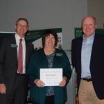 Macine Lukach, an agent from NDSU Extension's Cavalier County, receives a Program Excellence Award for the Building Tomorrow's Leaders Today program from NDSU Extension Director Chris Boerboom (left) and Jim Murphy, Farm and Ranch Guide. (NDSU photo)