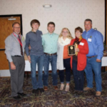 Rob and Christy Zelinsky Family of Bar Zel Suffolks, Brookings were named the 2017 South Dakota Master Lamb Producers in the Purebred Producer division. They were honored during the 80th Annual South Dakota Sheep Growers Convention held in Brookings. (left to right): Jeff Held, Exec. Secretary, South Dakota Master Lamb Producers Association and Professor & SDSU Extension Sheep Specialist; Rhett Zelinsky, Riggen Zelinsky, Rasea Zelinsky, Christy and Rob Zelinsky. (Courtesy of iGrow.org)