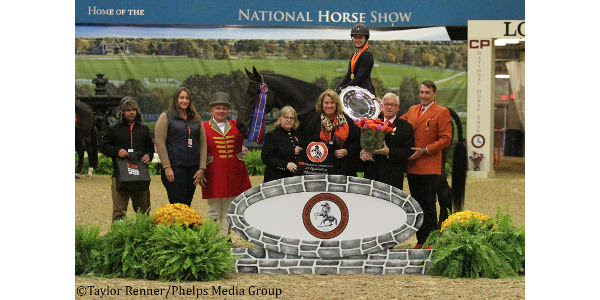 "Jaden Porter and Dragonfly's Corleone B claimed the first-ever National Horse Show 3'3"" Equitation Championship on Sunday. (Courtesy of Phelps Media)"