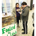 WIU senior agriculture major Jessica Herndon, of Macomb, talks with a student about food labels during a recent educational event. (Courtesy of WIU)