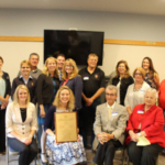 Over 30 attendees recently gathered to rededicate the student campus home for the Association of Women in Agriculture (AWA) located near the College of Agriculture and Life Sciences campus at the University of Wisconsin – Madison. (Courtesy of AWA)