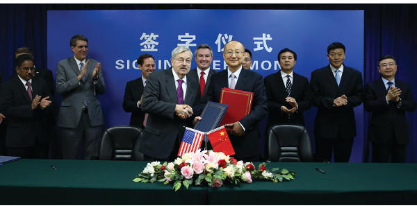 Agriculture Commissioner Ryan Quarles, center, stands behind United States Ambassador Terry Branstad and AQSIQ Minister Zhi Shuping after the signing of an accord which allows the resumption of United States equine exports to the People's Republic of China. (Courtesy of KDA)