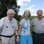 Left to right, John Wittrig, his daughter Laura, and Tom Wahl of Red Fern Farm in front of the 130 acres the Wittrig family protected with Iowa's first SILT conservation easement. (Courtesy of SILT)