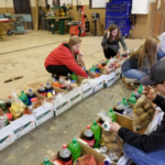 Clark County FFA collected enough food for 100 families in their food drive. They worked with Clark County Farm Bureau and other local businesses to provide each family with a turkey, eggs, and rolls as well. (Courtesy of Kentucky FFA Association)