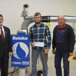 Collin Overmann of Elkhorn is studying irrigation technology at the Nebraska College of Technical Agriculture in Curtis. He received scholarship support from Holdrege Irrigation and Reinke Irrigation last week presented by NCTA Dean Ron Rosati, left, with Dan Stehlik, ag mechanics instructor. (Brent Thomas/NCTA News photos)