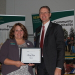 Chris Boerboom, NDSU Extension Service director (right) presents a certificate recognizing 5 years of service to Mary Berg. (Courtesy of NDSU Extension)