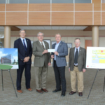 Bob Schmidt, Senior Vice President for FCSAmerica in South Dakota, second from right, presents a $500,000 gift in support of the SDSU Precision Agriculture Facility to SDSU President Barry Dunn, second from left, Bill Gibbons, Interim Director of the South Dakota Agricultural Experiment Station, left, and Interim Dean of the College of Agriculture and Biological Sciences Don Marshall, right. (Courtesy of SDSU)