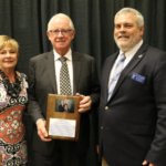 JoAnne (left) and Howard Hillman (center) accept the 2017 South Dakota State University Distinguished Department of Animal Science Award from Dr. Joe Cassady, SDSU Animal Science Department Head. (Courtesy of SDSU)