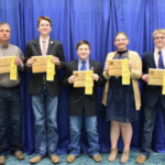 The first place 2017 South Dakota 4-H Senior Livestock Judging Team represented South Dakota at the North American International Livestock Exposition on November 14, 2017. Pictured here, left to right: Coach Robert Peterson, Ben Connor, Logan Schlim, Hanna Peterson and Carter Calmus. (Courtesy of iGrow.org)