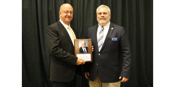 Glenn Muller, Executive Director of the South Dakota Pork Producer's Council, left, is presented with the SDSU Friend of the Department of Animal Science Award by Dr. Joe Cassady, SDSU animal Science Department Head. (Courtesy of SDSU)