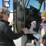 Making sure producers feel appreciated and get a complimentary lunch during harvest is the goal of South Dakota Farmers Union Harvest Lunch Program. Here, Pam Evenson, S.D. Farmers Union Membership Specialist hands out a lunch during harvest. (Courtesy photo)