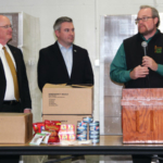 Michael Halligan, right, CEO of God's Pantry Food Bank, talks about what the meals will mean to the people his organization serves as Agriculture Commissioner Ryan Quarles, center, and William M. Landrum III, secretary of the Kentucky Finance and Administration Cabinet, listen in during a press conference Wednesday at God's Pantry in Winchester. (Kentucky Department of Agriculture photo)