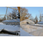 Photo 1. Heavy, wet snow accumulation on the double-poly greenhouse resulted in collapse of the greenhouse structure. (All photos by W. Garrett Owen)