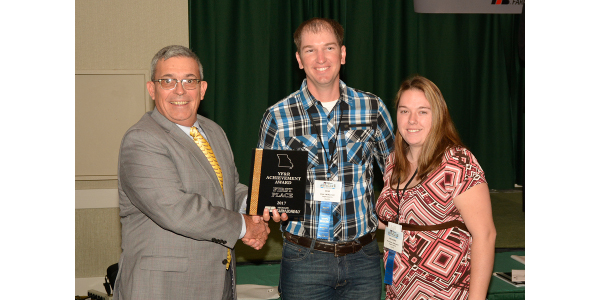 YF&R Achievement winners Clint and Mercedes Wilkerson of Carthage, received the award from MFB President Blake Hurst at the organization's annual meeting Dec. 5. (Courtesy of Missouri Farm Bureau)