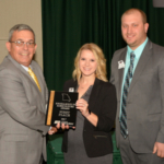 YF&R Excellence in Agriculture winners Dylan and Meredith Lange of Dawn, Mo., received their award from MFB President Blake Hurst at the organization's annual meeting Dec. 5. (Courtesy of MOFB)