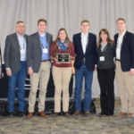 The Peters family of Bellevue, IA received the 2017 Iowa BQA Cow-Calf Award. Pictured (L-R): Doug Bear, IBIC, Charlie, Michael, Miranda, Sam, Jenni and Mathias Peters. (Courtesy of Iowa Beef Industry Council)