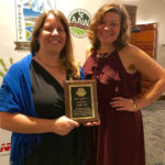 Katie Yost (left) of Montana receives American Agri-Women's LEAVEN award from Kimberly Schmuhl (right), AAW LEAVEN committee chair. (Courtesy of American Agri-Women)