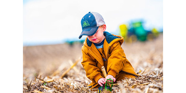 """The grand-prize winner is Brian Biesemeier of Sedgwick, Colo., with the entry entitled """"Farming with Dad."""" (Courtesy of Colorado Department of Agriculture)"""