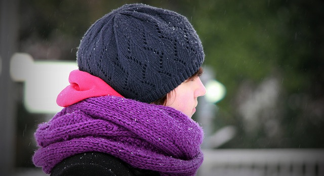 Anonymous woman knits hats for those in need